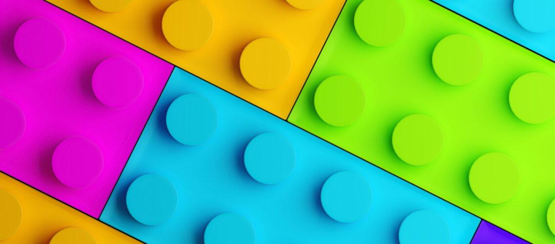 Plastic building blocks background. 3d render